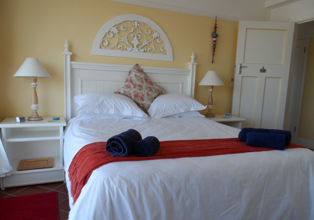 Comfortable queen size bed with a view over the Simon's Town naval base